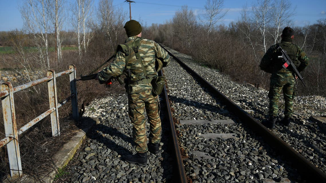 Greek soldiers stand on the railway tracks as they patrol next to the Greek-Turkish border near the village of Marasia, in the region of Evros, Greece March 7, 2020. REUTERS/Alexandros Avramidis