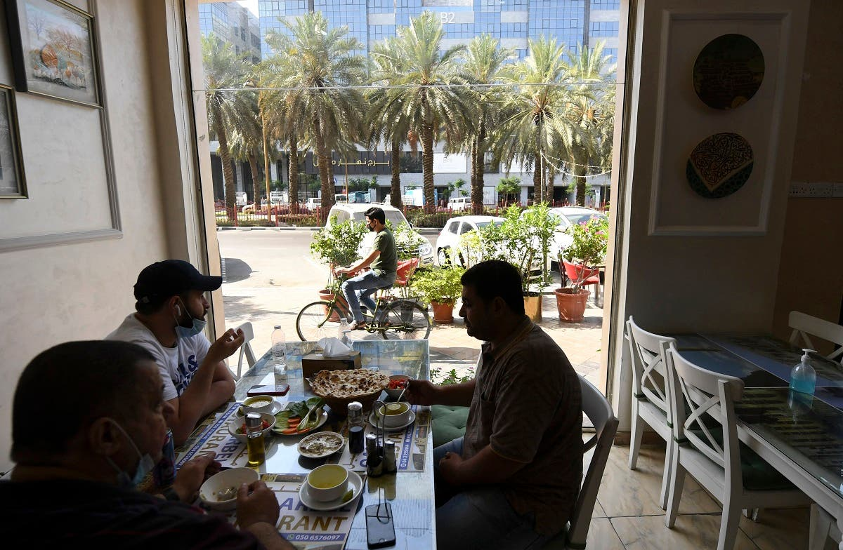 People sit at restaurant in Dubai on May 26, 2020 as the Gulf emirate moved to ease their lockdown measures amid the COVID-19 coronavirus pandemic. (AFP)