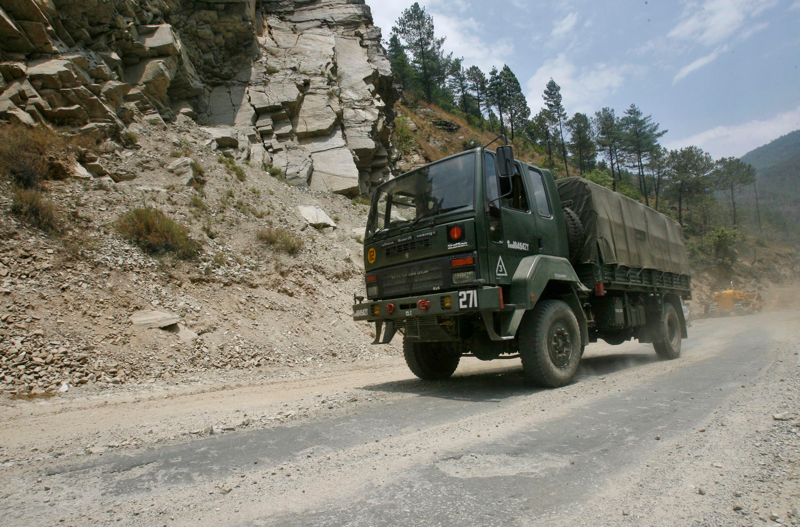 An Indian army truck drives along India's Tezpur-Tawang highway, which runs to the Chinese border, in the northeastern Indian state of Arunachal Pradesh in India. (Reuters)