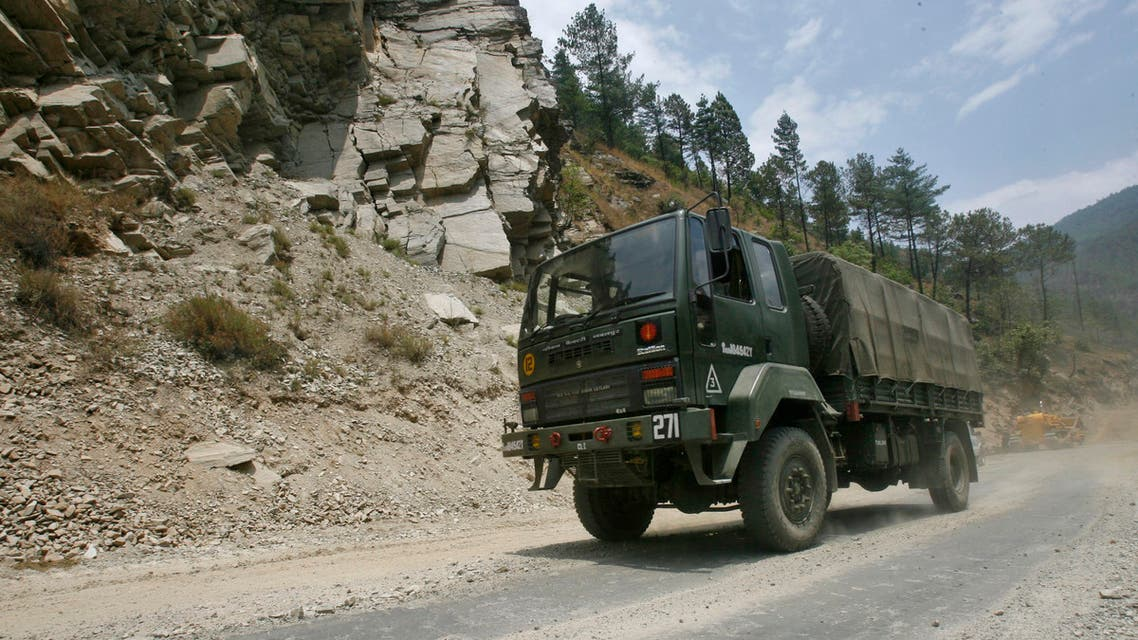 An Indian army truck drives along India's Tezpur-Tawang highway, which runs to the Chinese border, in the northeastern Indian state of Arunachal Pradesh May 28, 2012. Picture taken May 28, 2012. To match Special Report INDIA-CHINA/ REUTERS/Frank Jack Daniel (INDIA - Tags: POLITICS BUSINESS CONSTRUCTION MILITARY)