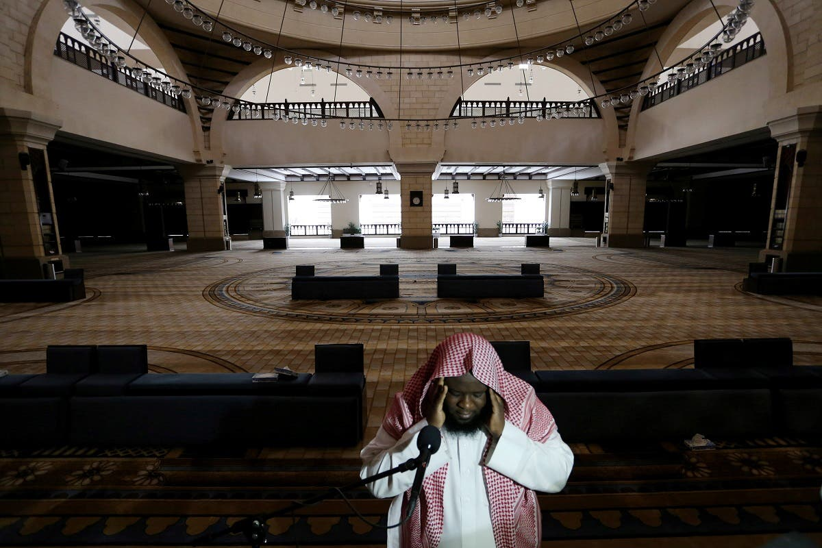 A cleric calls for the prayer at an empty Al-Rajhi Mosque, as Friday prayers were suspended following the spread of the coronavirus disease (COVID-19), in Riyadh. (Reuters)