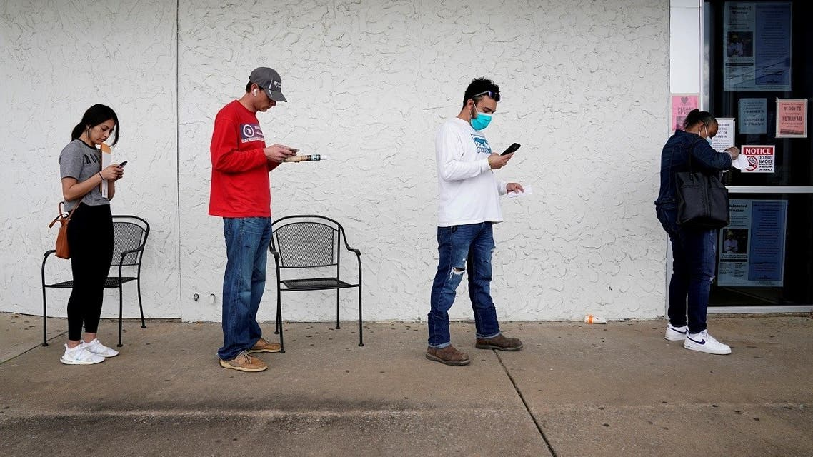 People who lost their jobs wait in line to file for unemployment following an outbreak of the coronavirus disease (COVID-19), at an Arkansas Workforce Center in Fayetteville, Arkansas, US. (File photo: Reuters)