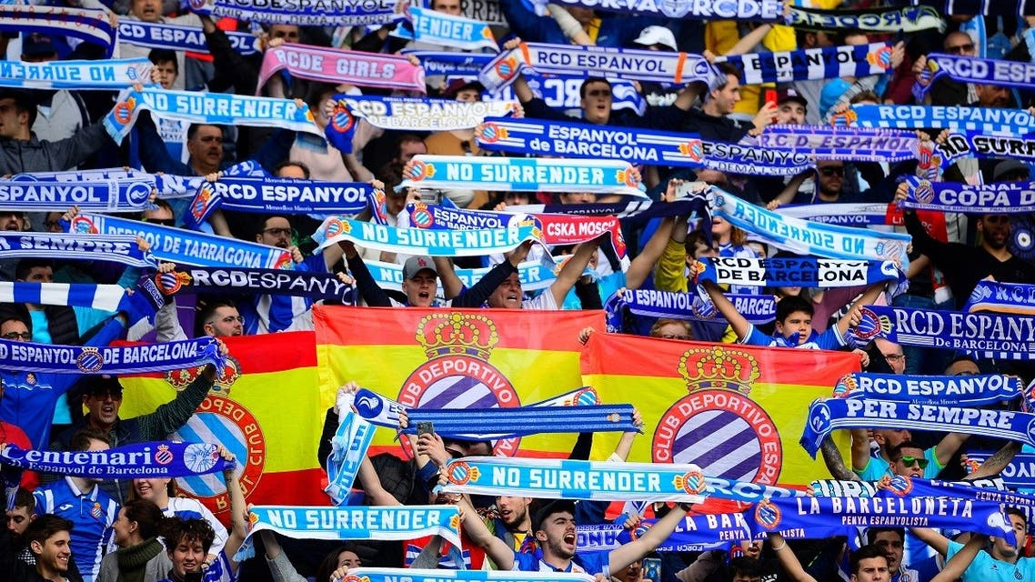 Espanyol fans hold up their scarves during the Spanish League football match between Espanyol and Atletico Madrid at the Cornella-El Prat stadium in Cornella de Llobregat on March 1, 2020. (AFP)