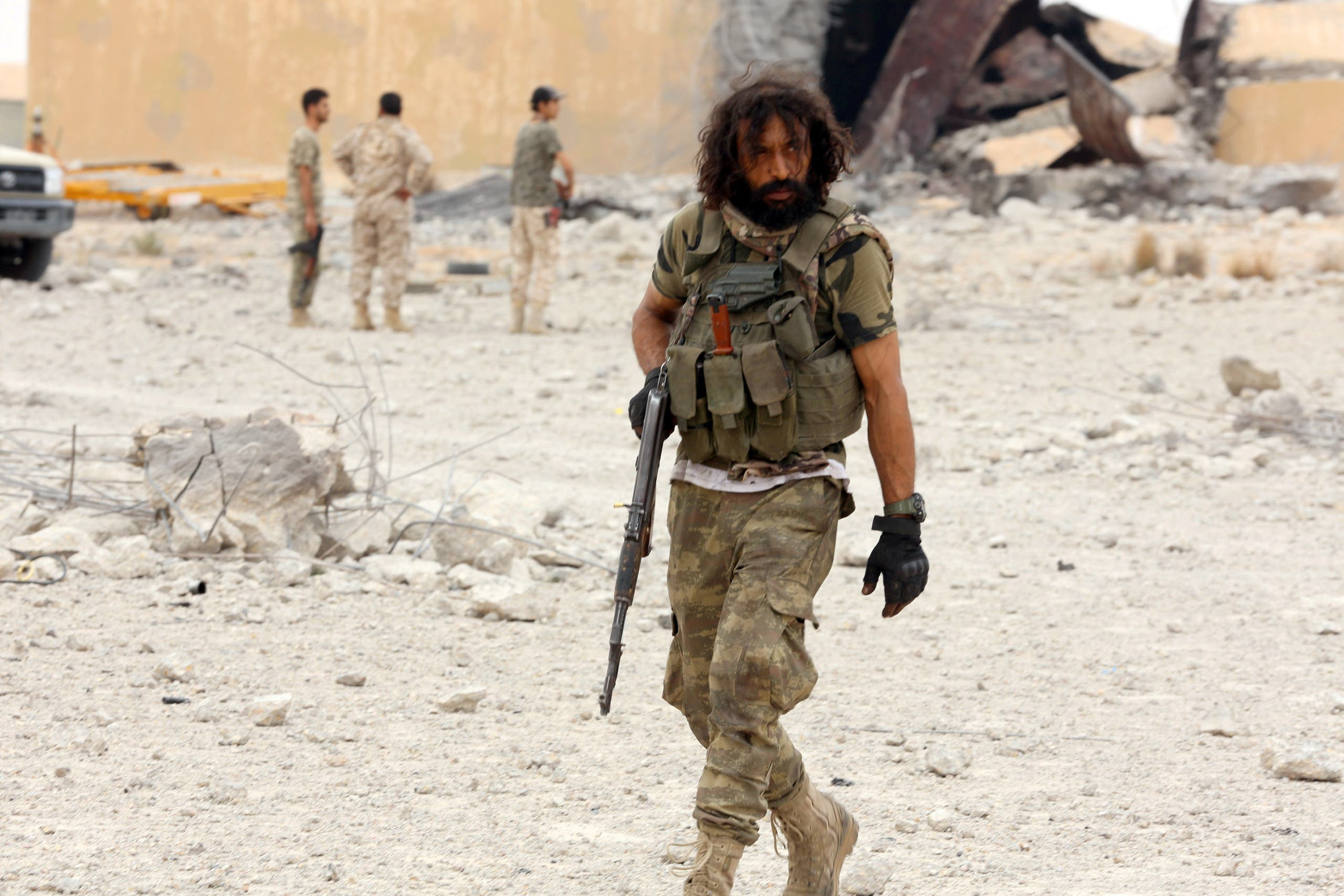 A member of the GNA holds his weapon after taking control of Watiya airbase, southwest of Tripoli, Libya May 18, 2020. (File photo: Reuters)