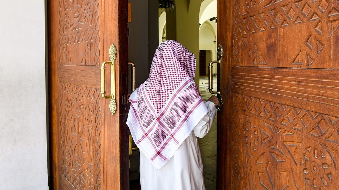 Imam Mohammed, muezzin of the Jaffali mosque in Saudi Arabia's Red Sea coastal city of Jeddah, enters the mosque which is closed due to a government decree as part of efforts to combat the COVID-19 coronavirus pandemic, during the Muslim holy month of Ramadan on April 28, 2020. (AFP)