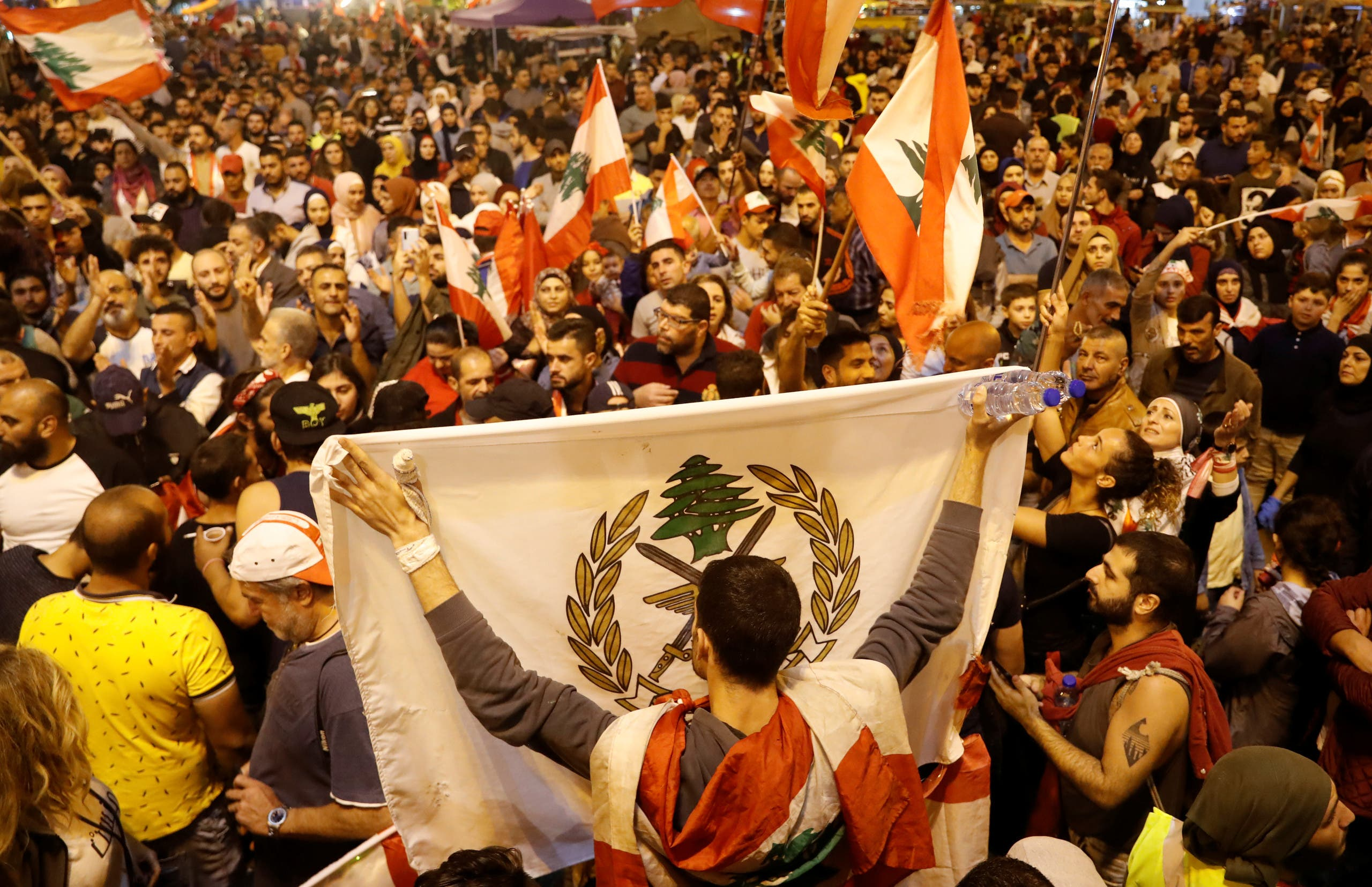 A demonstrator holds a Lebanese Army flag during a protest in Tripoli, Lebanon, November 2, 2019. (Reuters)