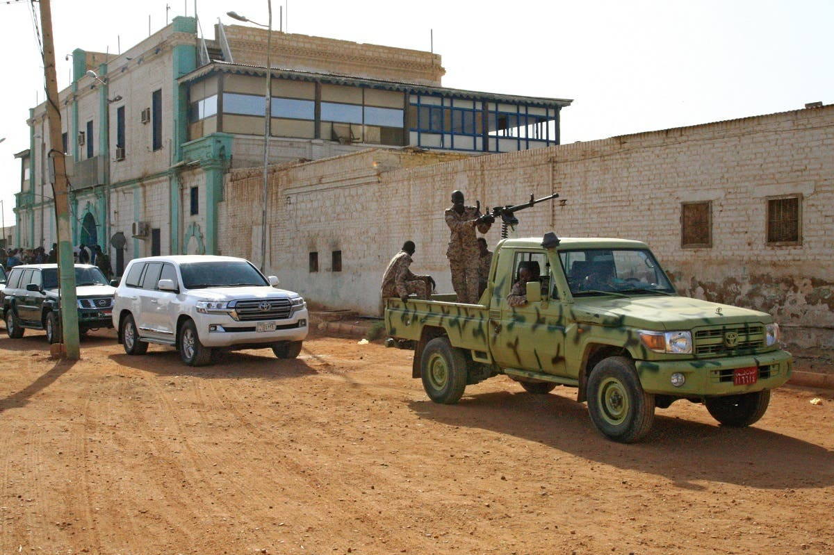 This picture taken on June 16, 2019 shows a view of vehicles in the convoy transporting Sudan's ousted president as he is taken from Kober prison. (File photo: AFP)