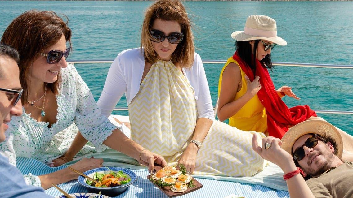 Elli Kriel, founder of Elli's Kosher Kitchen, samples some of her dishes with friends in Dubai. (Courtesy: Elli Kriel)