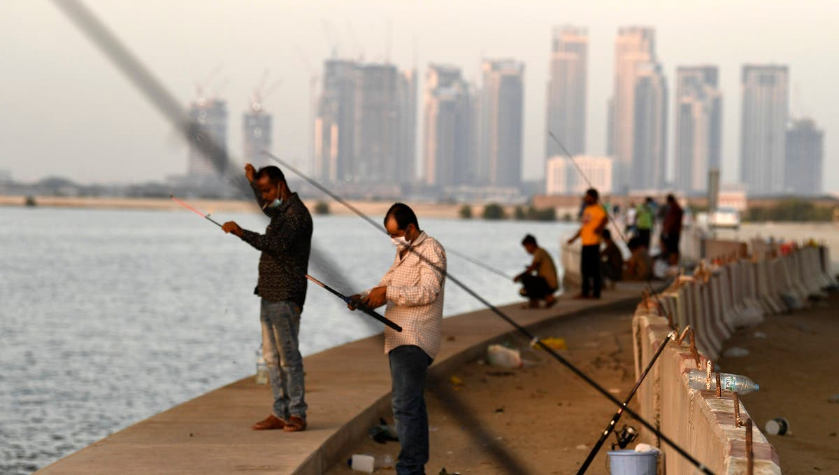 Men gather to fish at the creek in the Gulf city of Dubai, after the Emirati authorities eased some of the restrictions that were put in place in a bid to stem the spread of the novel coronavirus, on May 27, 2020. (AFP)