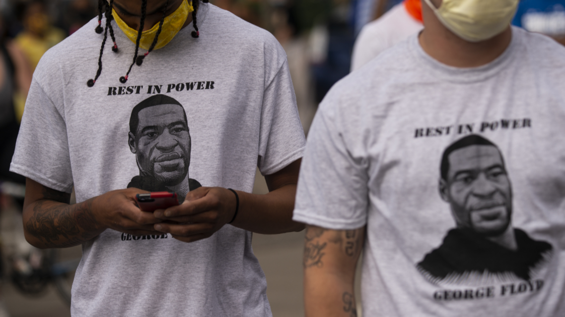 Two men wear shirts stating Rest in Power George Floyd on May 27, 2020 in Minneapolis, Minnesota. (AFP)