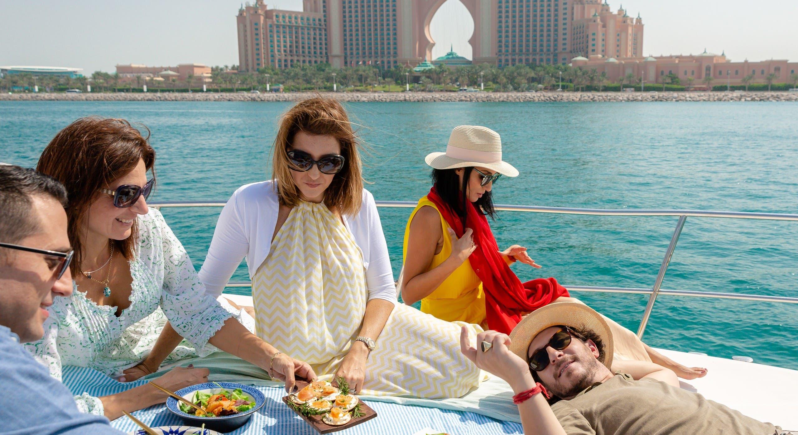 Elli Kriel, founder of Dubai-based Elli's Kosher Kitchen, samples some of her dishes with friends in Dubai. (Courtesy: Elli Kriel)