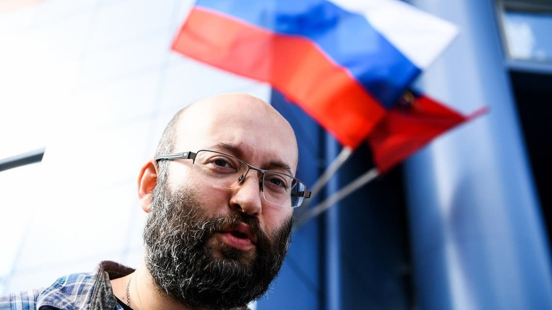 In this file photo taken on September 3, 2019, Ilya Azar, a municipal deputy working for top opposition newspaper Novaya Gazeta, speaks with journalists near the court in Moscow. (AFP)