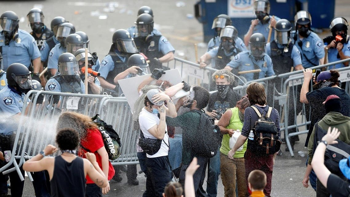 Police spray mace at protestors to break up a gathering near the Minneapolis Police third precinct after a white police officer was caught on a bystander's video pressing his knee into the neck of African-American man George Floyd, who later died at a hospital, in Minneapolis, Minnesota, U.S. May 27, 2020. (Reuters)