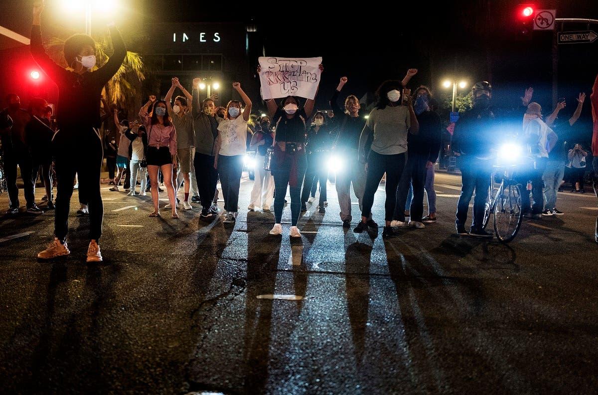 Demonstrators block traffic during a protest Wednesday, May 27, 2020, in Los Angeles over the death of George Floyd in Minneapolis police custody earlier in the week. (AP)