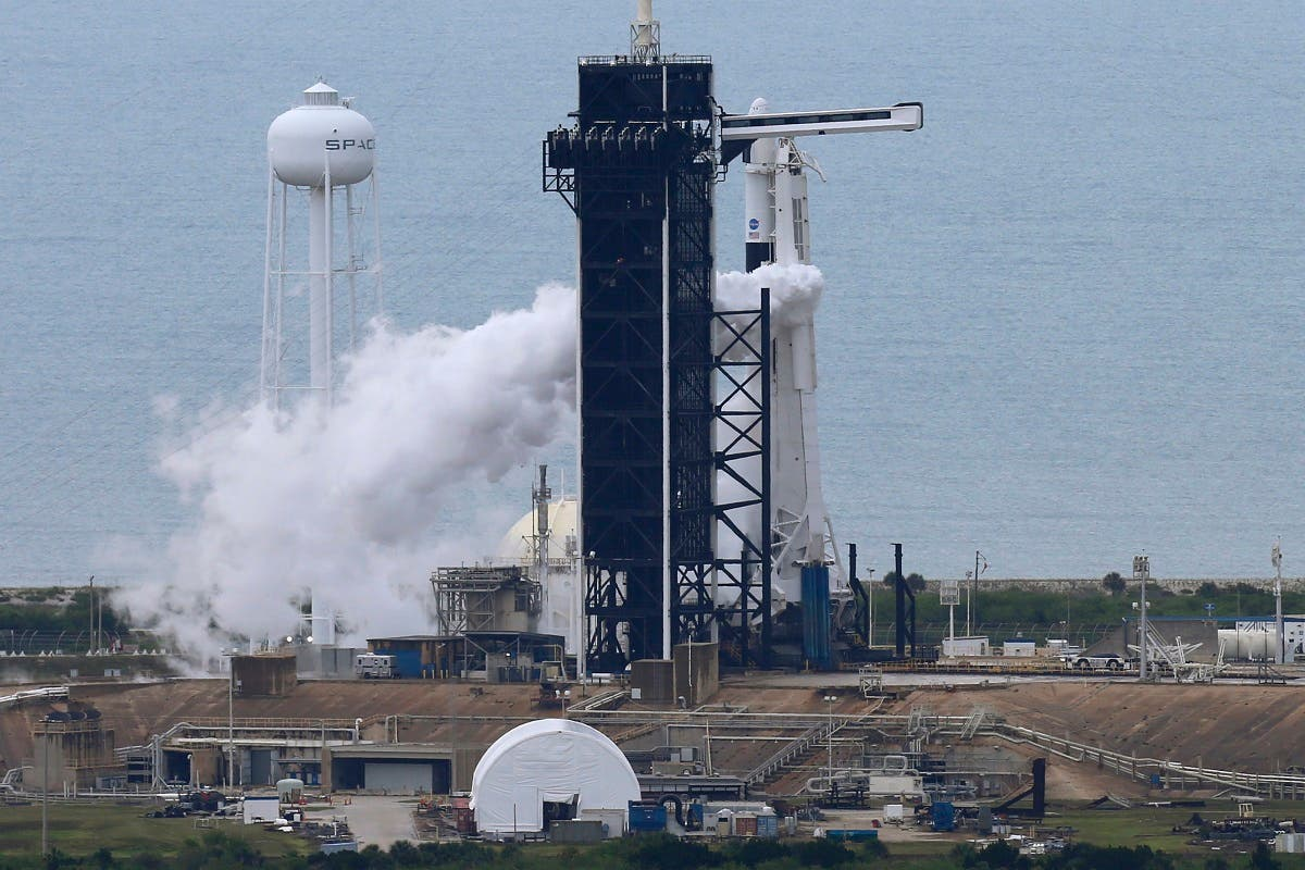 A SpaceX Falcon 9 rocket purges fuel after topping off before scheduled launch of NASA's SpaceX Demo-2 mission to the International Space Station from NASA's Kennedy Space Center in Cape Canaveral. (Reuters)