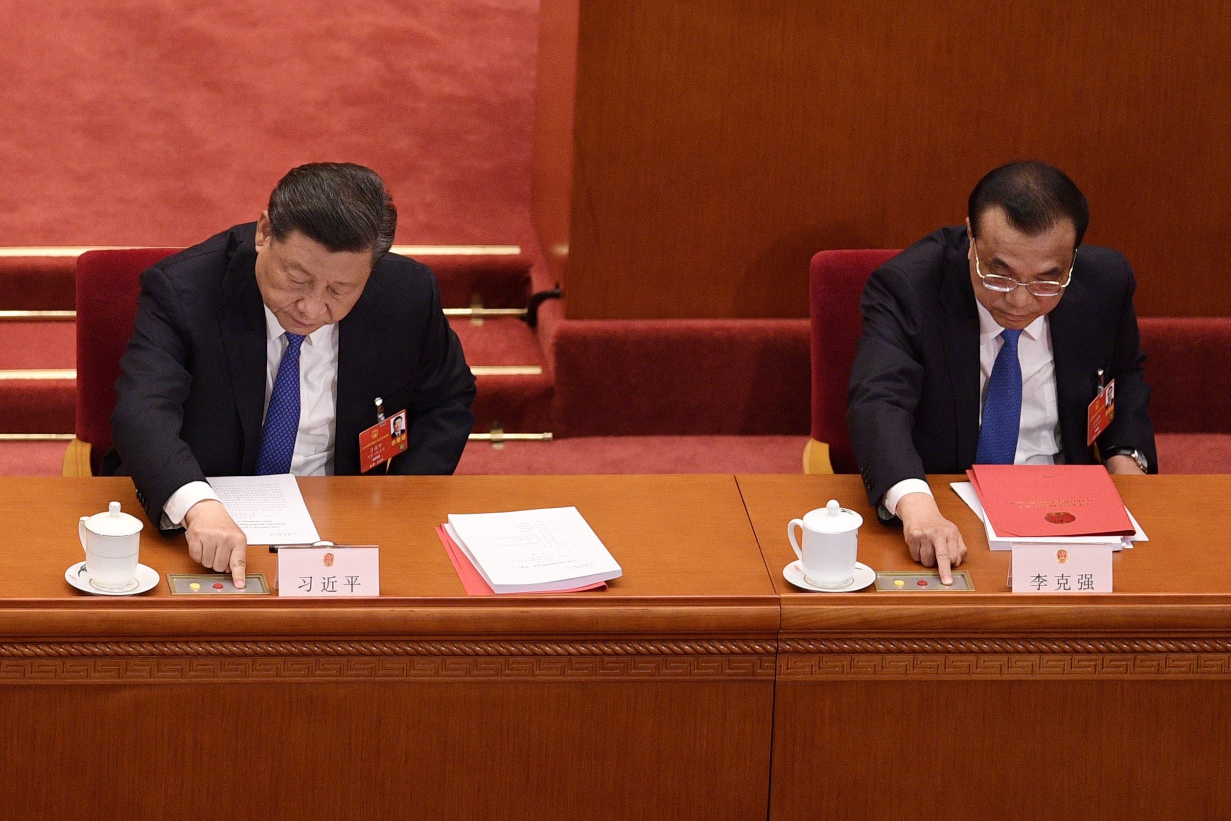 الرئيس الصيني مصوتا على قانون الأمن القومي المتعلق بهونغ كونغ (أرشيفية- فرانس برس)
