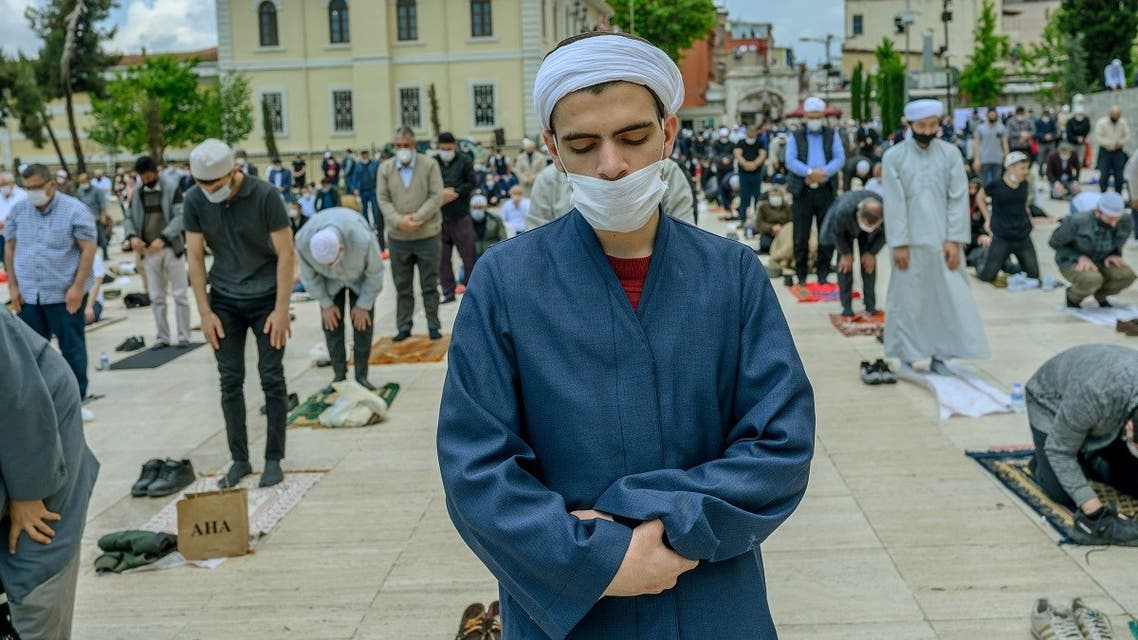 Worshippers wearing protective facemasks maintain the required social distance during the Friday prayer outside The Fatih Mosque in Istanbul on May 29, 2020. (AFP)