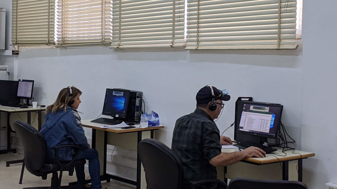 Volunteers work at the coronavirus hotline at Rafik Hariri Hospital in Beirut, Lebanon. (Emily Lewis)
