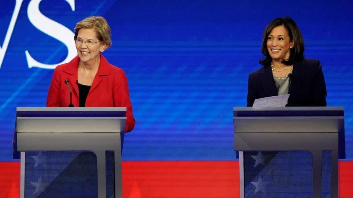 Senator Elizabeth Warren and Senator Kamala Harris smile during the 2020 Democratic US presidential debate in Houston, Texas, US, September 12, 2019. (Reuters)