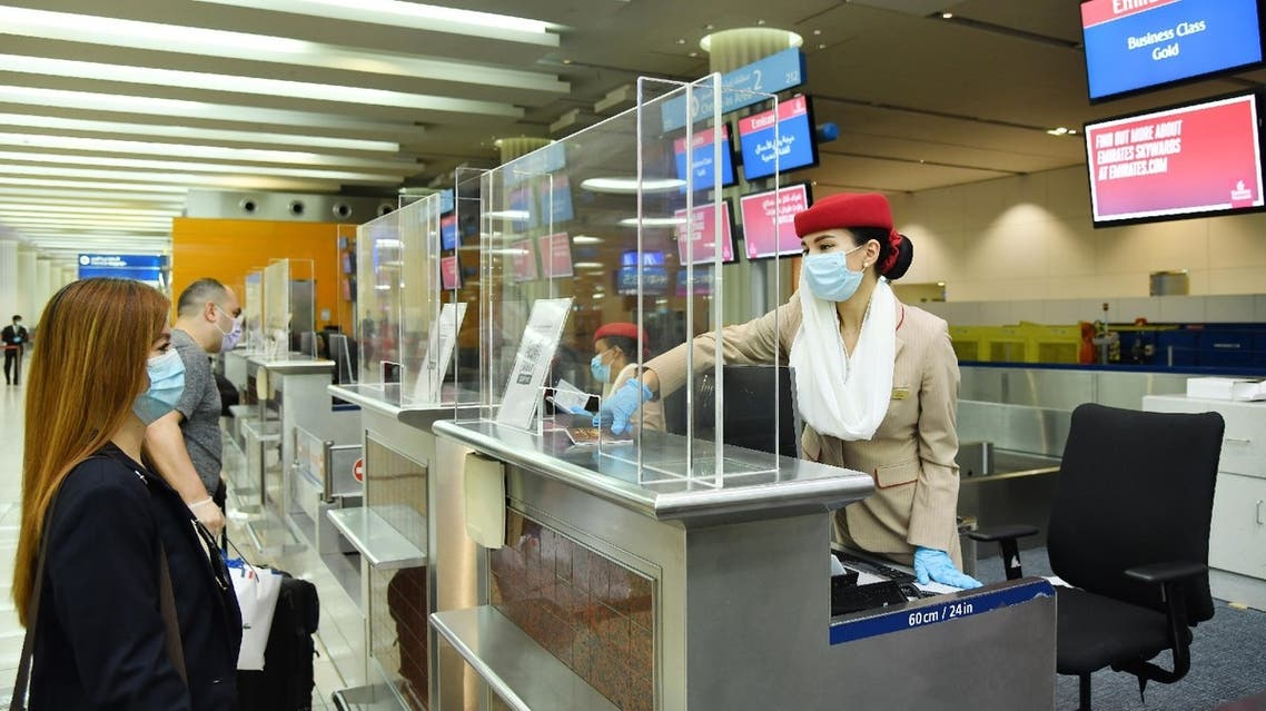 Emirates airlines implement coronavirus safety precautions at airport check-in counters in Dubai, UAE. (Twitter/@Emirates)