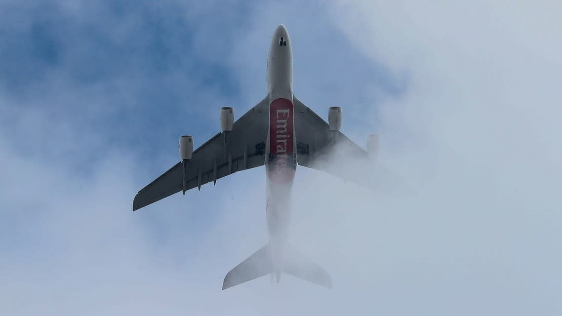 An Emirates Airlines passenger jet in the air. (File photo: AFP)