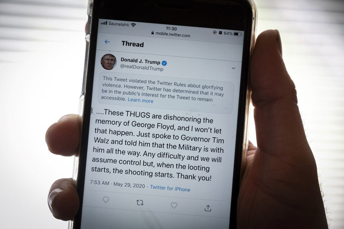 The twitter page of President Donald Trump's is displayed on a mobile phone in Vaasa, Finland, on May 29, 2020. (AFP)