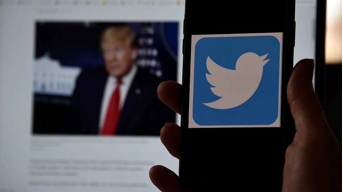 In this photo illustration, a Twitter logo is displayed on a mobile phone with President Trump's Twitter page shown in the background on May 27, 2020, in Arlington, Virginia. (AFP)