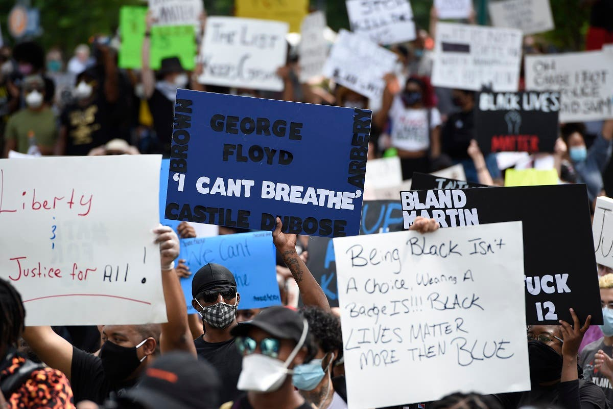 Demonstrators protest in Centennial Olympic Park, Friday, May 29, 2020 in Atlanta. (AP)