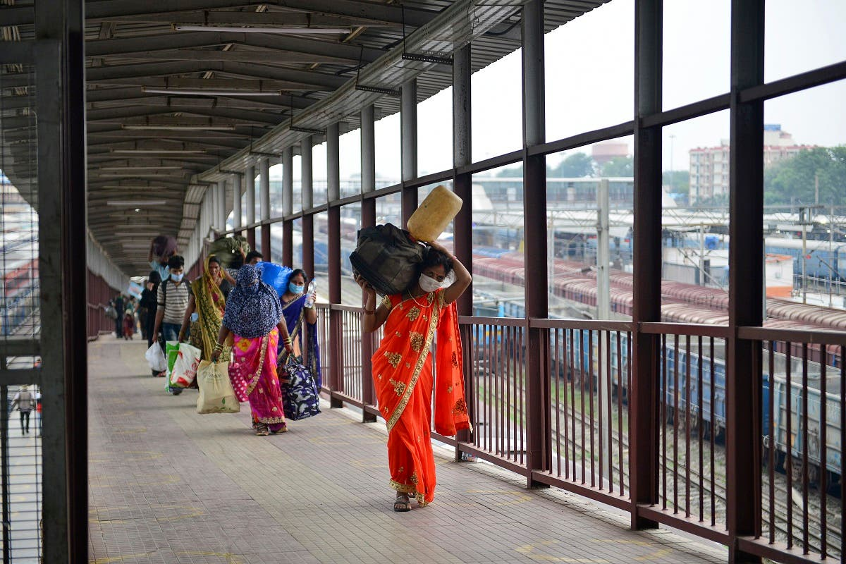 Passengers arrive from Mumbai after the government eased a nationwide lockdown to prevent the spread of the coronavirus, at the railway station in Allahabad on May 30, 2020. (AFP)