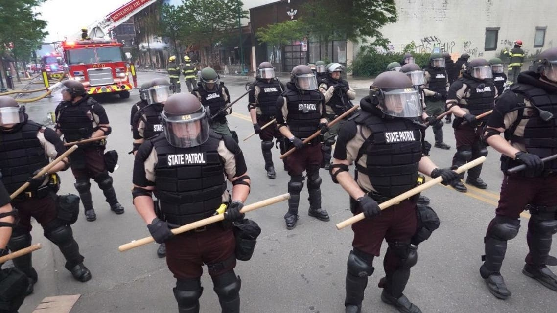 Police secure a perimeter following a night of rioting sparked by the death of George Floyd while in police custody on May 29, 2020 in Minneapolis, Minnesota, US. (AFP)