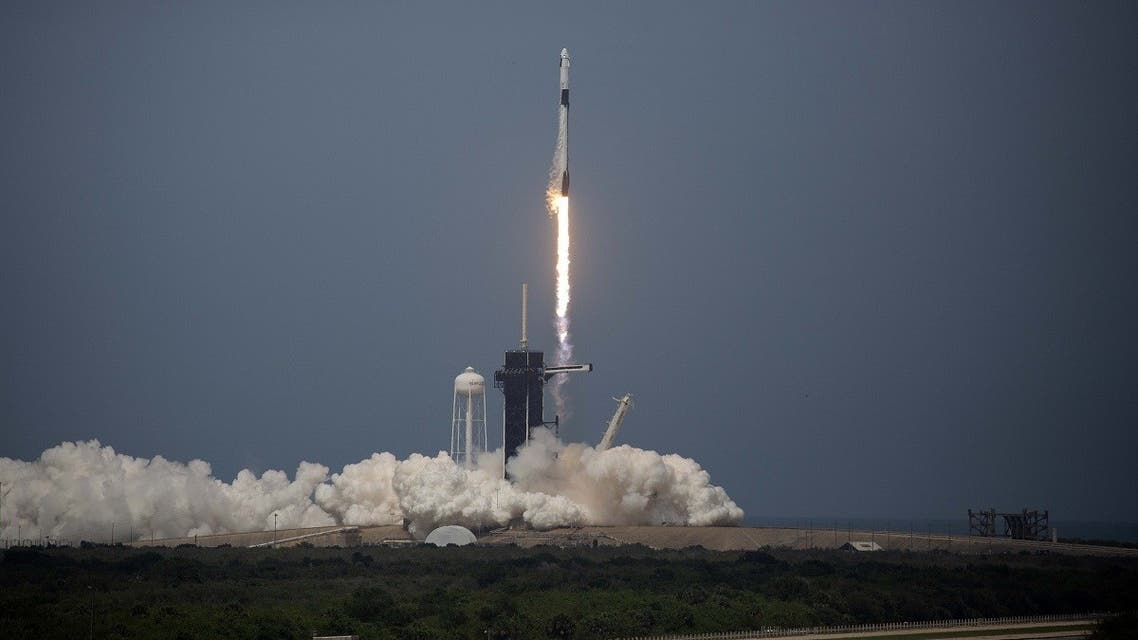 The SpaceX Falcon 9 rocket launches into space with NASA astronauts Bob Behnken (R) and Doug Hurley aboard the rocket from the Kennedy Space Center on May 30, 2020 in Cape Canaveral, Florida. (AFP)