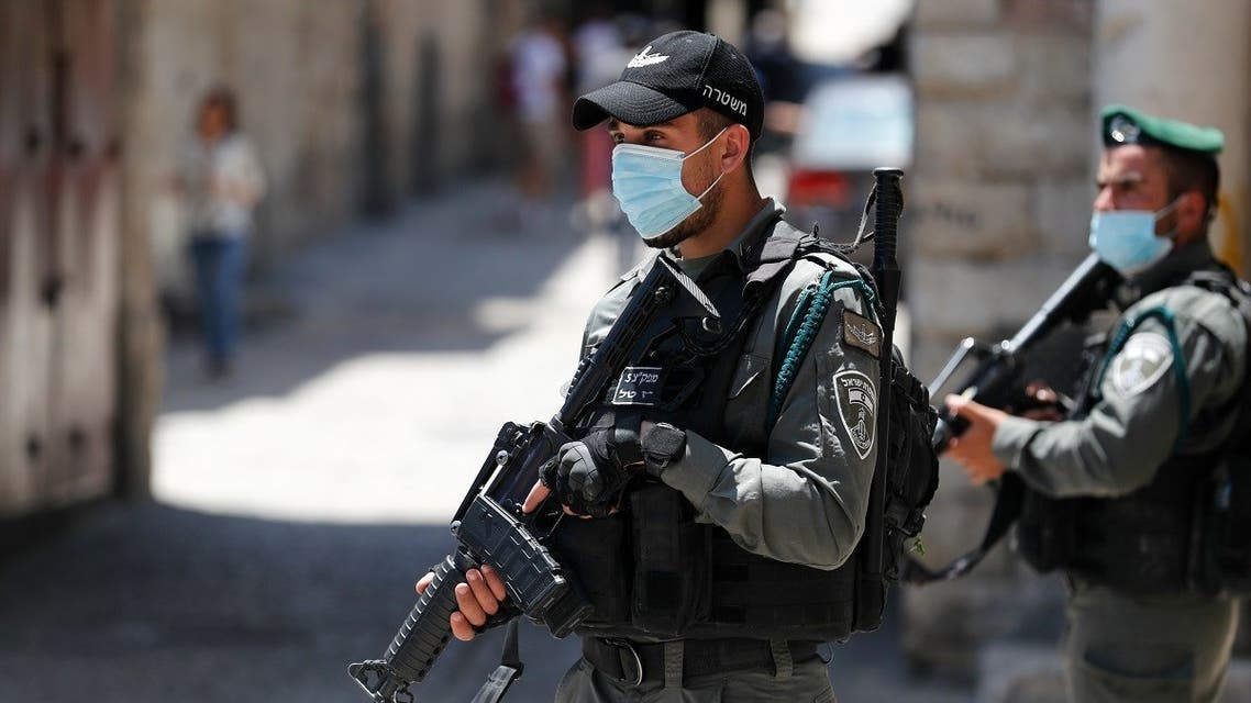 Member of the Israeli security forces patrol in the area where Israeli police in annexed east Jerusalem shot dead a Palestinian with special needs on May 30, 2020. (AFP)