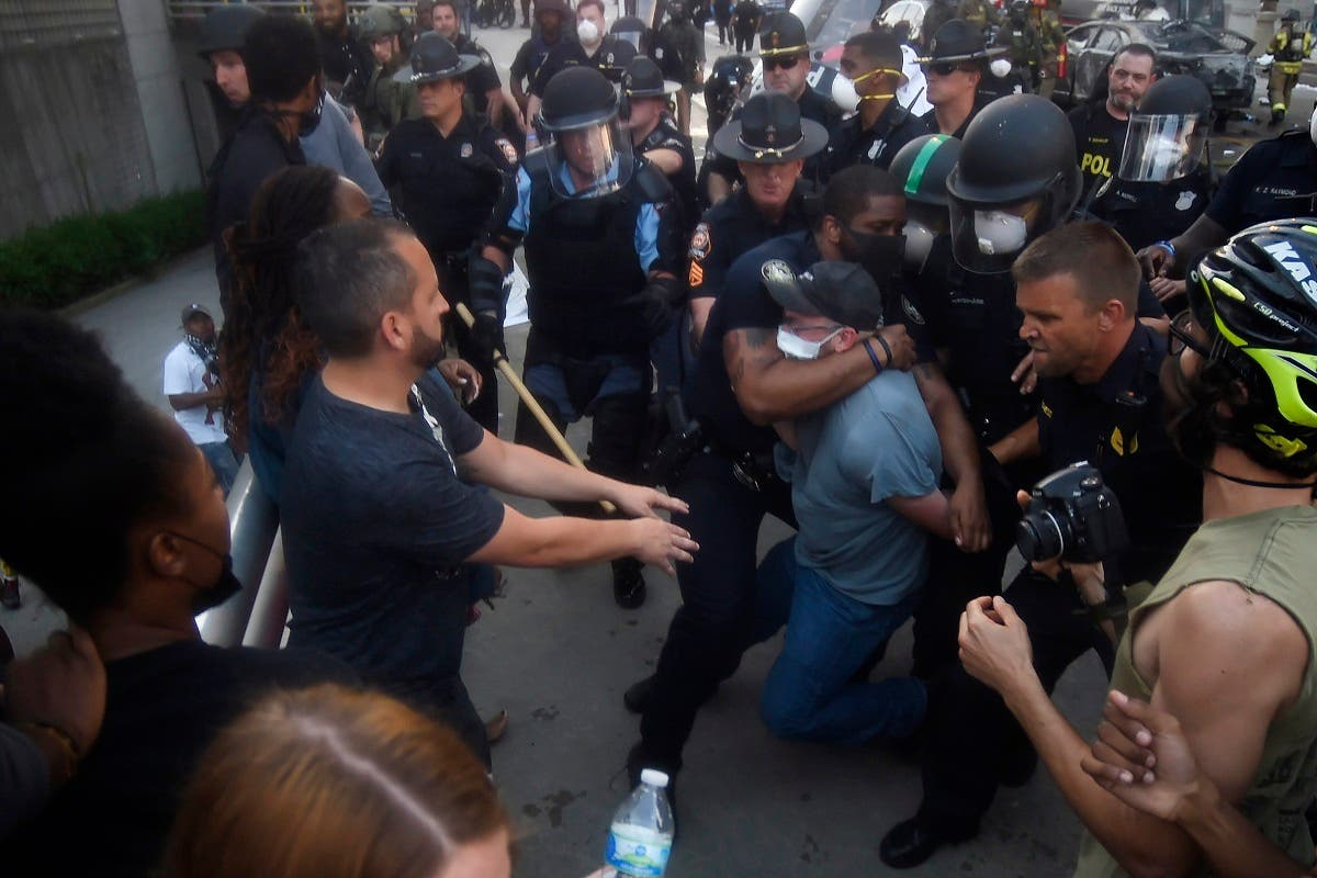 Police officers and protesters clash near CNN center, Friday, May 29, 2020 in Atlanta. (AP)