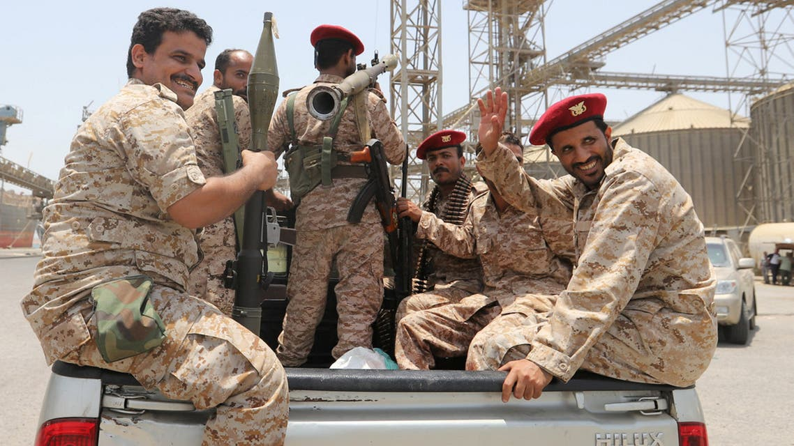 Yemen's Houthi movement forces ride in the back of a vehicle during withdrawal from Saleef port in Hodeidah province, Yemen May 11, 2019. Picture taken May 11, 2019. REUTERS/Abduljabbar Zeyad