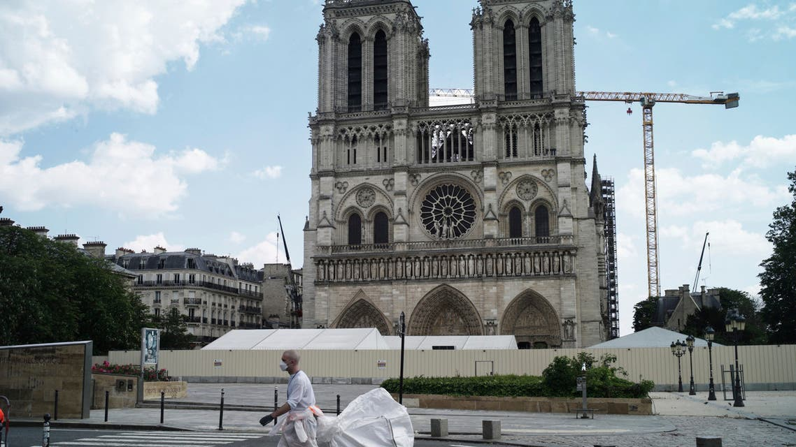 A worker cleans around the Notre Dame Cathedral during nationwide confinement measures to counter the COVID-19 pandemic, in Paris, Monday, April 27, 2020. (AP)