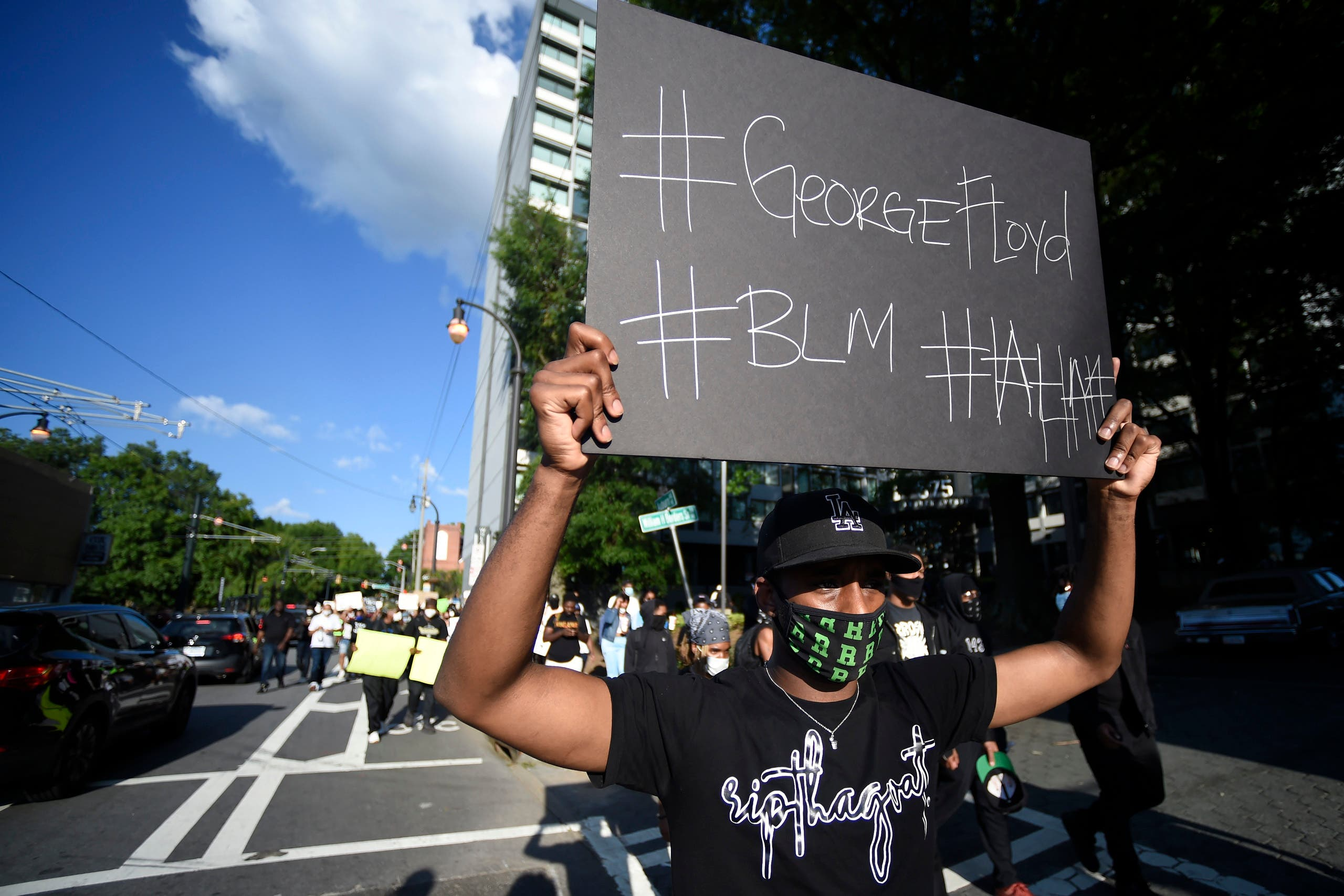 Demonstrators march near Ebenezer Baptist Church, Friday, May 30, 2020 in Atlanta. (AP)