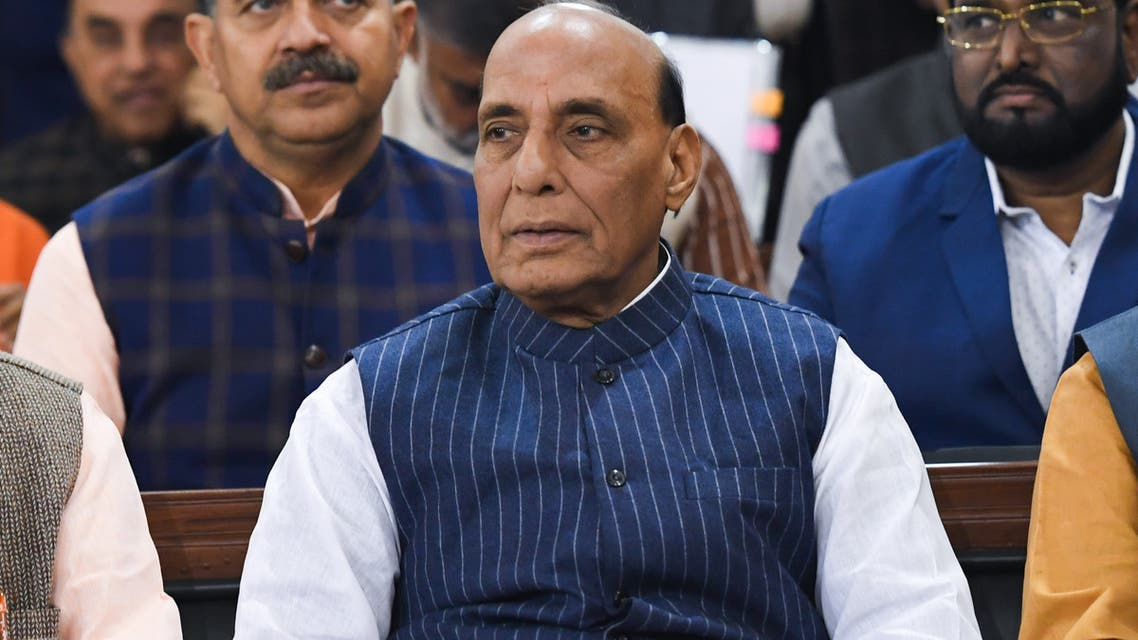 India's Defence Minister Rajnath Singh (C) attends an event at the Parliament House in New Delhi on December 3, 2019.
