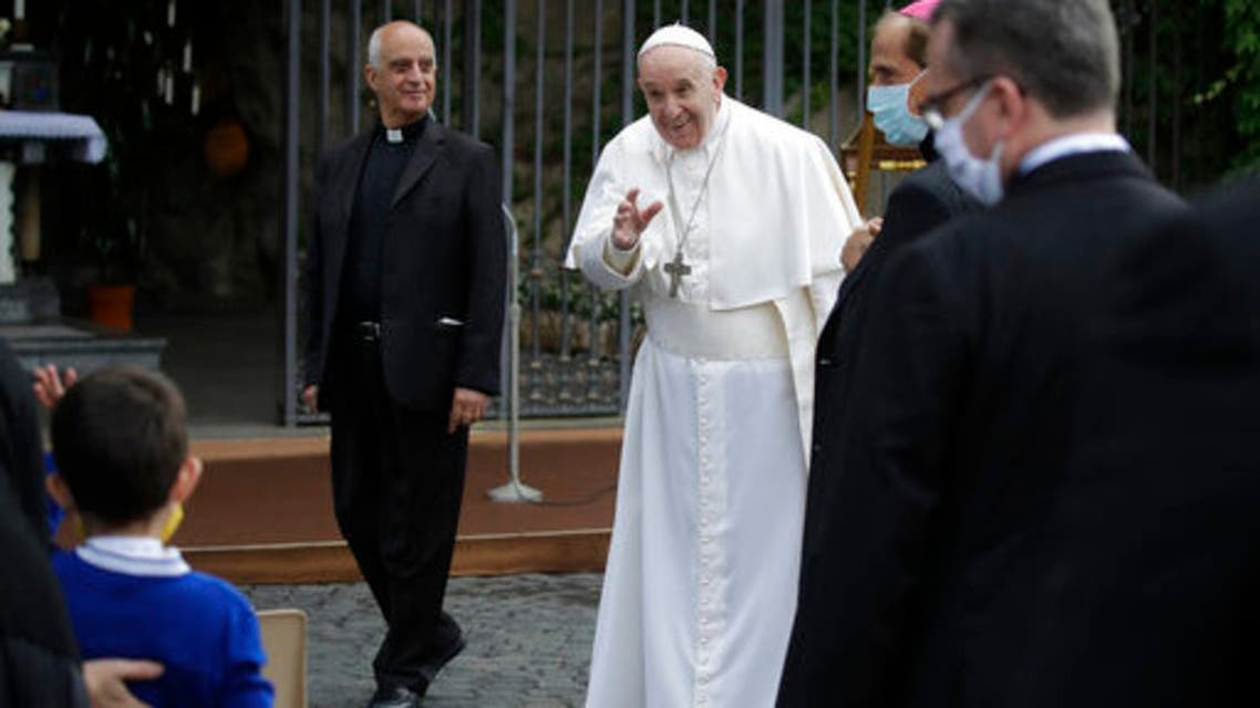 Pope Francis waves as he leaves after a rosary in Vatican gardens Saturday, May 30, 2020. (AP)