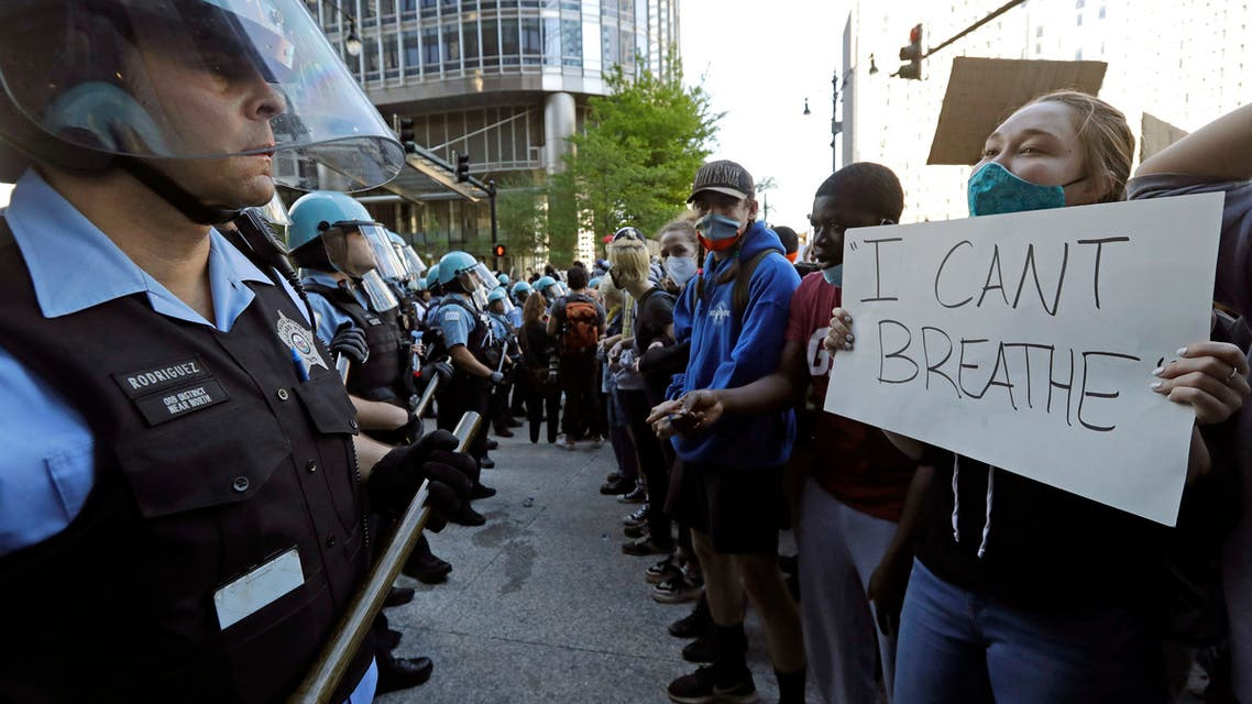 People confront police officers during a protest over the death of George Floyd in Chicago, Saturday, May 30, 2020. (Reuters)