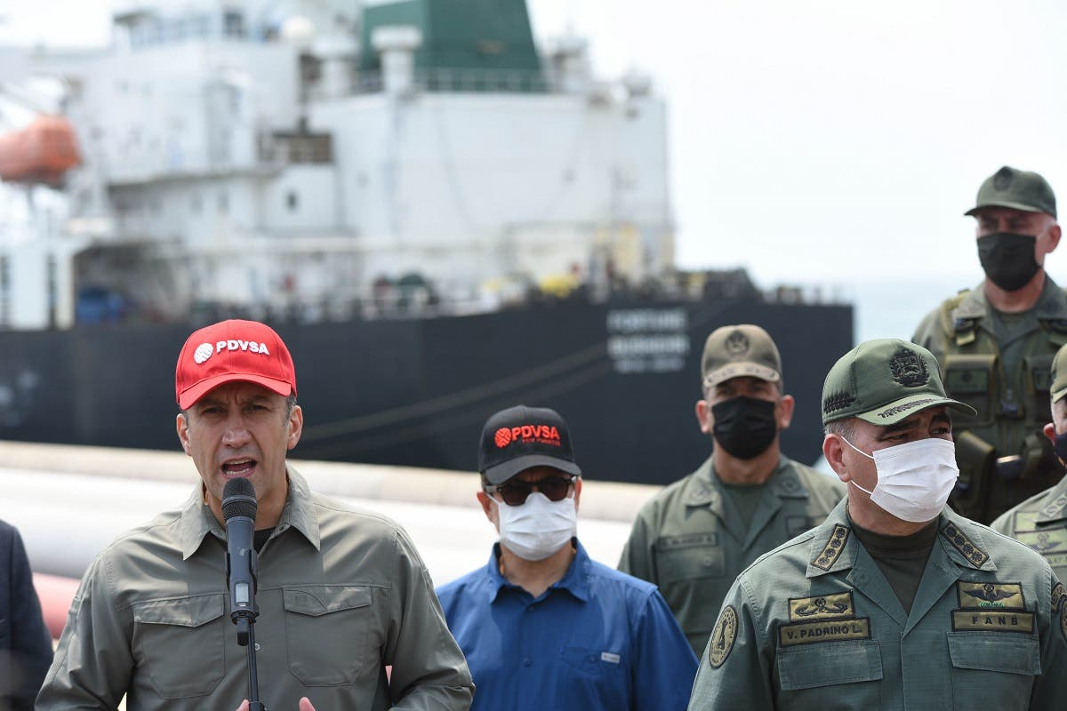 Venezuela's Industry Minister Tareck El Aissami (L), speaks next to defenSe Minister Vladimir Padrino(R) after the Iranian oil tanker Fortune docked at the El Palito refinery in Puerto Cabello, in the northern state of Carabobo, Venezuela, on May 25, 2020. (AFP)