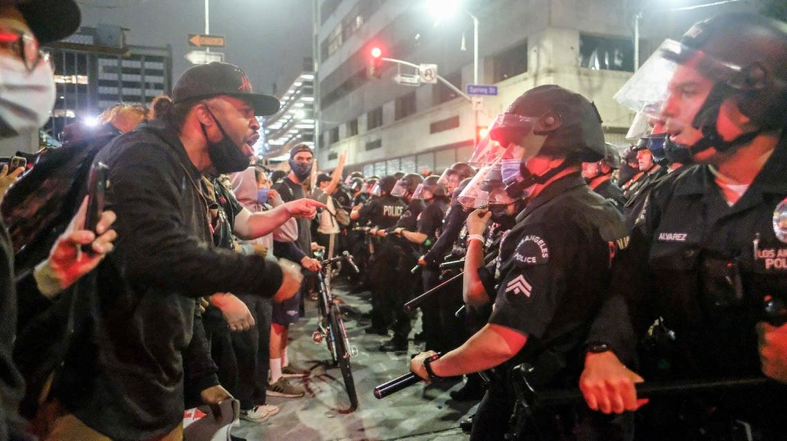 In this May 29, 2020, photo, protesters confront police officers during a protest over the death of George Floyd in Los Angeles. (AP)