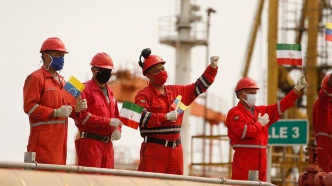 Workers of the state-oil company Pdvsa holding Iranian and Venezuelan flags greet during the arrival of the Iranian tanker ship Fortune at El Palito refinery in Puerto Cabello, Venezuela May 25, 2020. (Reuters)
