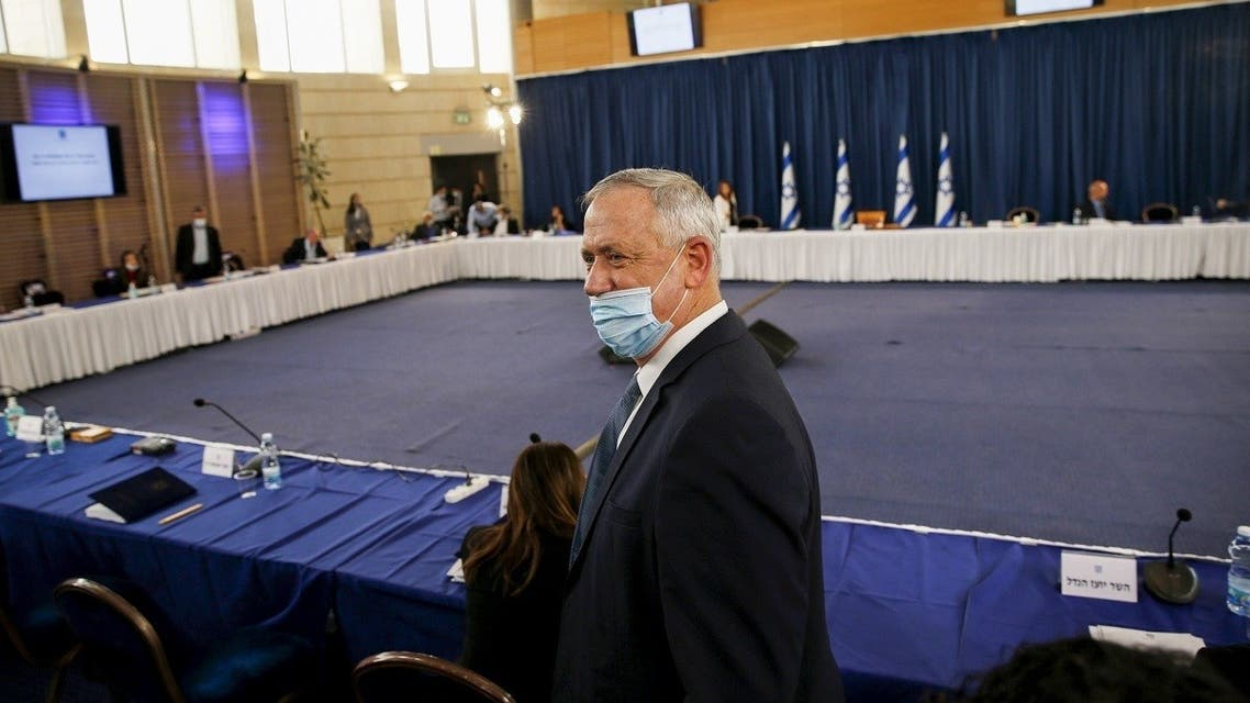 Israeli Defence Minister and Alternate Prime Minister Benny Gantz, wearing a protective face mask, arrives for the weekly cabinet meeting in Jerusalem on May 31, 2020. (AFP)
