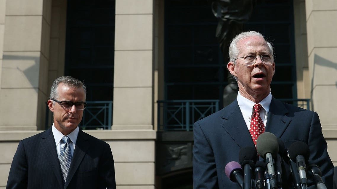 File photo of Boente (R), speaks while flanked by Andrew G. McCabe (L), Assistant Director in Charge of the FBI's Washington Field Office, after a hearing in federal court June 11, 2015 in Alexandria, Virginia. (AFP)