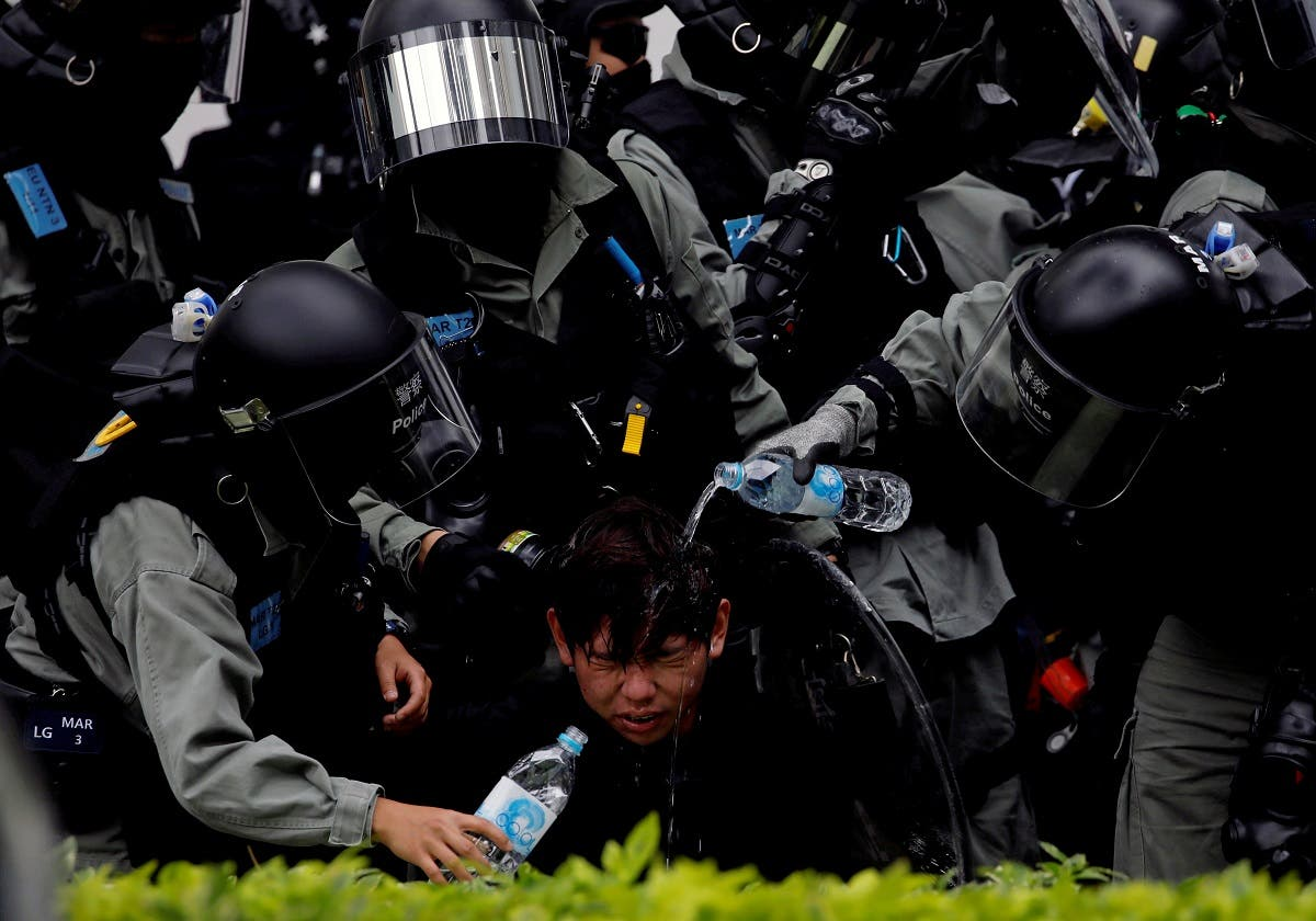 Riot police pour water on the face of anti-government protester at Sheung Shui, a border town in Hong Kong. (File photo: Reuters)