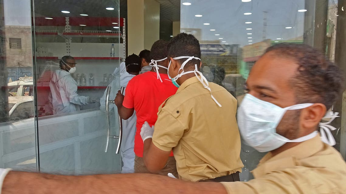 Mask-clad health workers enter the private al-Kubi Hospital in Yemen's southern coastal city of Aden on May 17, 2020, amid fears that coronavirus is spreading unhindered in the Yemeni city. Deaths in Aden have surged to five or even seven times higher than normal, an NGO and medics say. Six years of war against the Huthis -- and a widening fault-line among forces opposed to that rebel outfit -- have left authorities ill-equipped to control the spread of the virus.