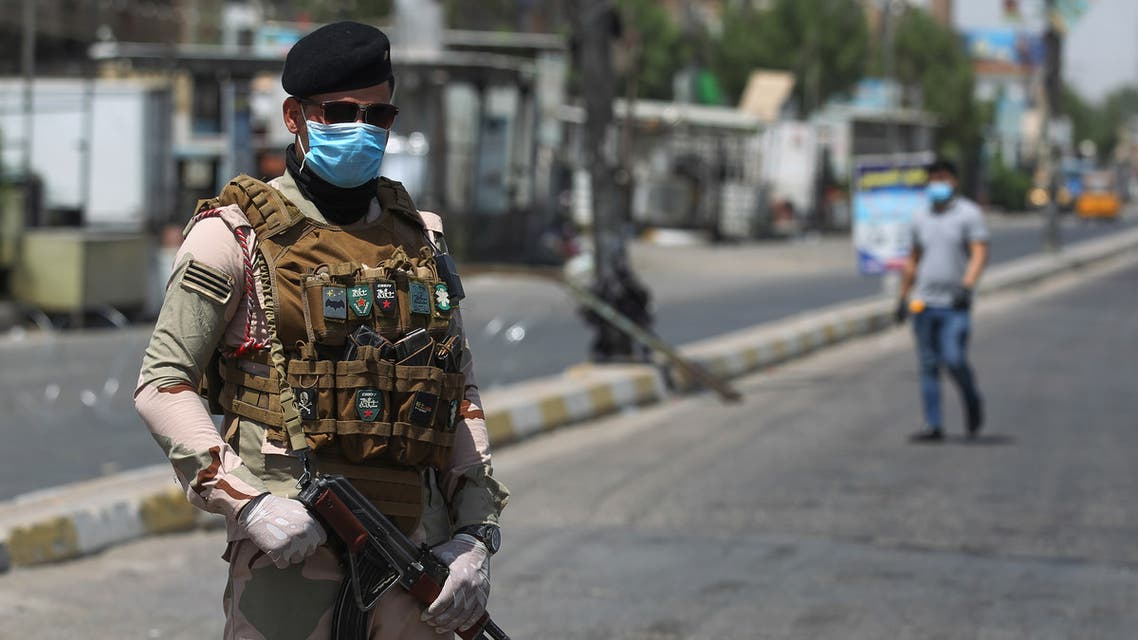 A member of the Iraqi security forces stands guard at a checkpoint, enforcing a curfew due to the COVID-19 coronavirus pandemic, in Baghdad's eastern Sadr City suburb on May 31, 2020. The Iraqi authorities imposed a week-long curfew to curb the latest increase in infections of coronavirus in the country.