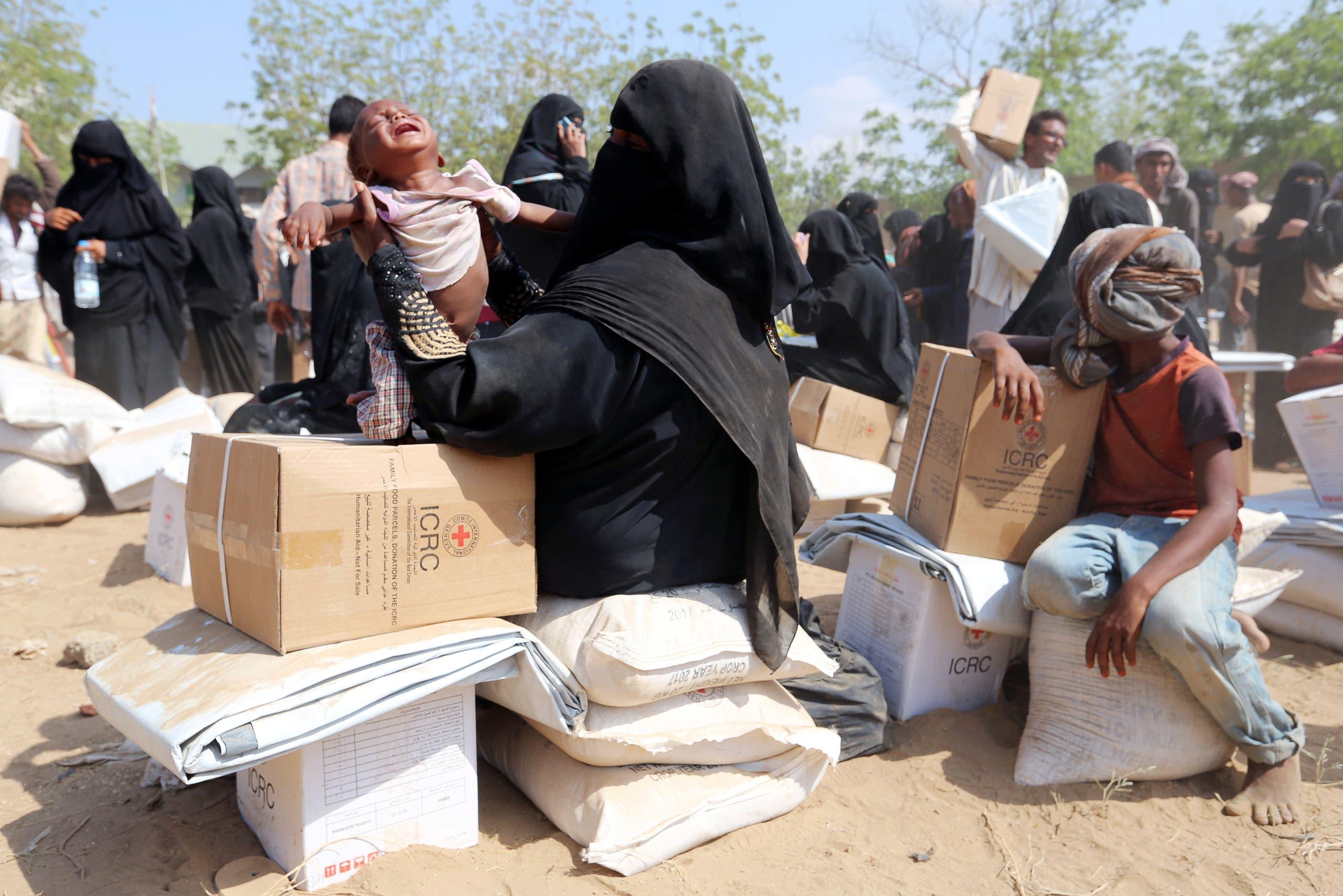 توزيع مساعدات في باجل باليمن