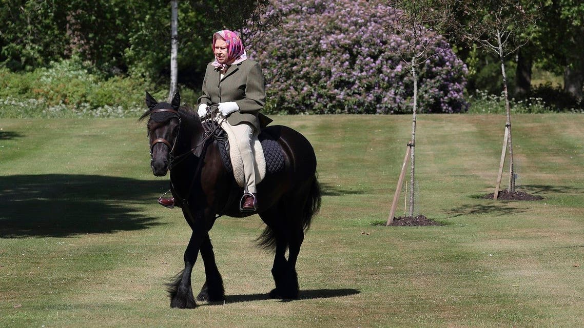 Britain's Queen Elizabeth II rides Balmoral Fern, a 14-year-old Fell Pony, in Windsor Home Park, west of London, over the weekend of May 30 and May 31, 2020. (AFP)