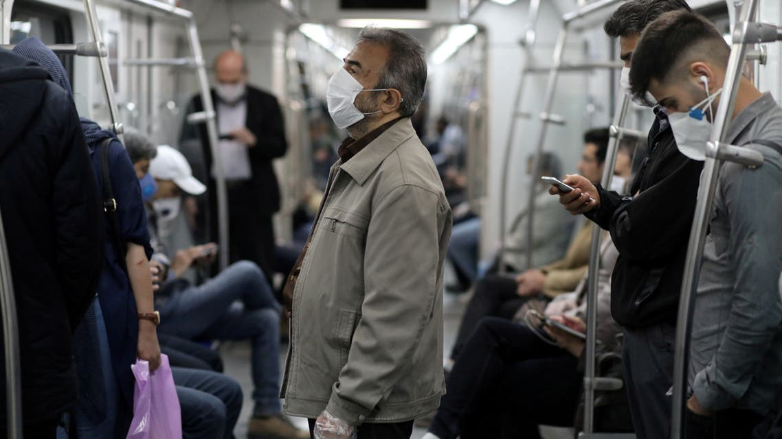 FILE PHOTO: Iranians wear protective face masks, following the outbreak of the coronavirus disease (COVID-19), as they travel on the metro, in Tehran, Iran, May 20, 2020. WANA (West Asia News Agency)/Ali Khara via REUTERS ATTENTION EDITORS - THIS PICTURE WAS PROVIDED BY A THIRD PARTY/File Photo